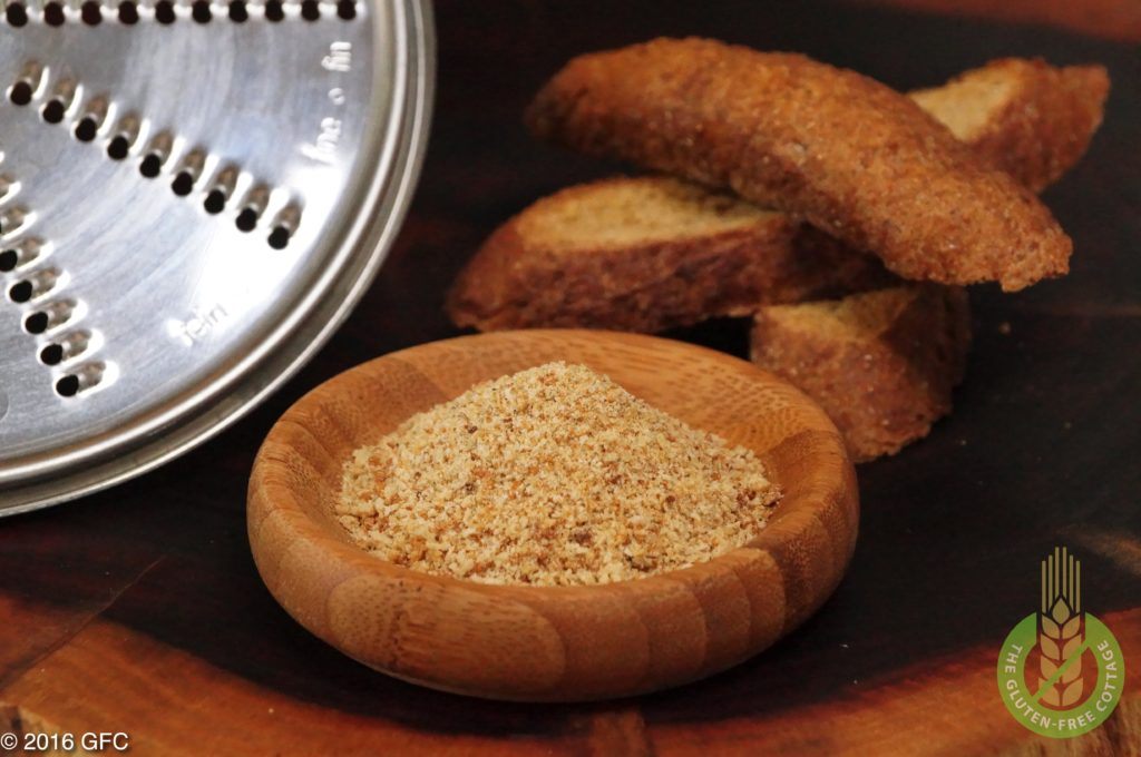 Using a special disk to make bread crumbs from heated old bread pieces with my food processor (gluten-free bread crumbs).