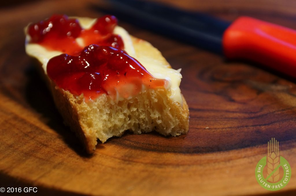 Enjoy a slice of yummy gluten-free French bread with butter and jam (or white bread).