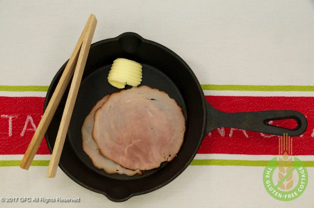 Pan-fry smoked ham in a skillet (gluten-free eggs Benedict).