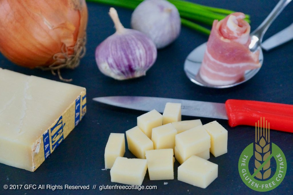 Swiss Gruyere cheese cut in pieces (gluten-free cheese spaetzle with bacon and onion).