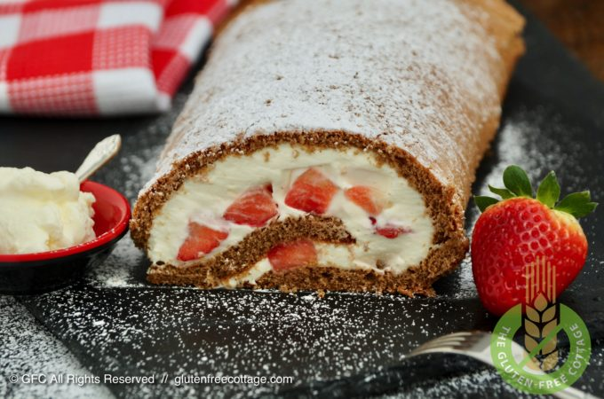 Gluten-free chocolate roll cake with strawberries.